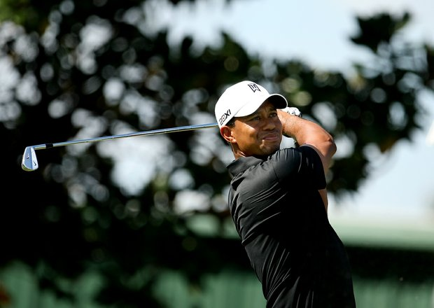 Tiger Woods hits his tee shot at No. 2 during the first round.