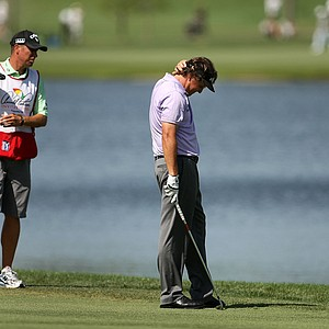 Phil Mickelson reacts after hitting his third shot after his drive found the water at No. 3 during the first round of Bay Hill.