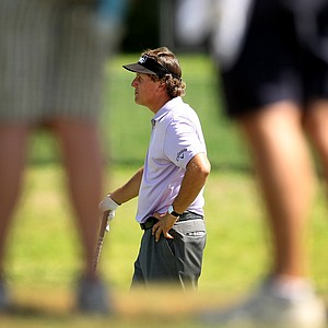Phil MIckelson can be seen through the gallery's legs as he waits to hit at No. 4 during the first round.