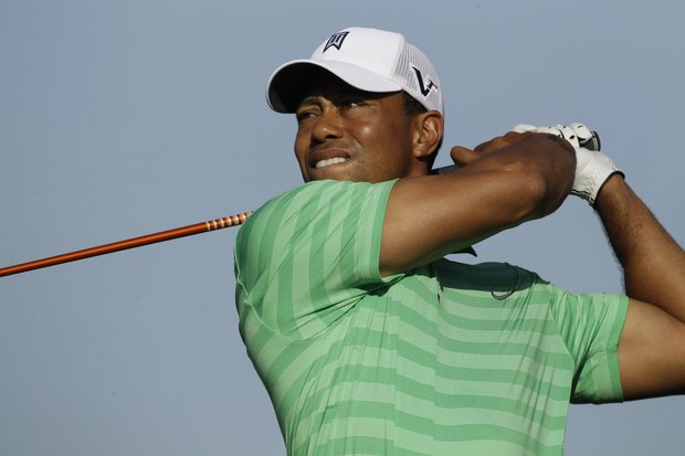 Tiger Woods tees off on the 10th tee at 8:26 a.m. EDT with Ernie Els and Hunter Mahan.
