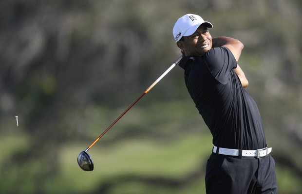 Tiger Woods hits a shot from the 16th tee during the first round of the Arnold Palmer Invitational.