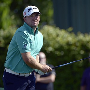 Graeme McDowell, of Northern Ireland, watches his tee shot on the ninth hole during the second round of the Arnold Palmer Invitational.