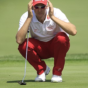 Ian Poulter, of England, lines up a shot on the ninth green during the second round of the Arnold Palmer Invitational.