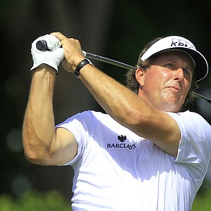 Phil Mickelson hits a shot from the ninth tee during the second round of the Arnold Palmer Invitational.