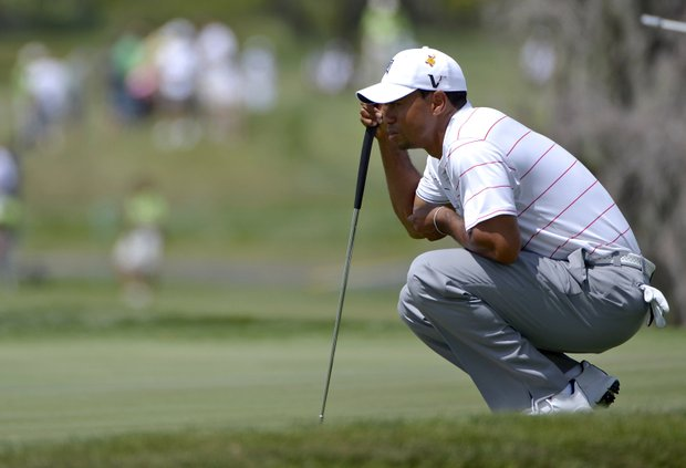 Tiger Woods lines up a putt on the third green during the second round of the Arnold Palmer Invitational.
