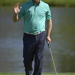 Graeme McDowell, of Northern Ireland, acknowledges the crowd after making a birdie putt on the eighth green during the second round of the Arnold Palmer Invitational.