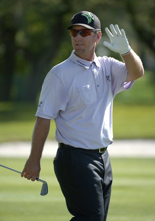 David Duval waves to the crowd after hitting his shot from the ninth fairway during the second round of the Arnold Palmer Invitational.
