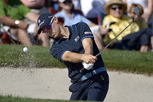 Ben Crane hits out of a greenside bunker on the eighth hole during the second round of the Arnold Palmer Invitational.