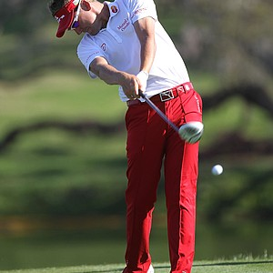 Ian Poulter of England plays a shot on the 16th hole during the second round of the Arnold Palmer Invitational.