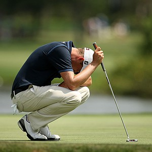 Nick Watney reacts to missing his second putt at No. 6 during the third round of the Arnold Palmer Invitational.