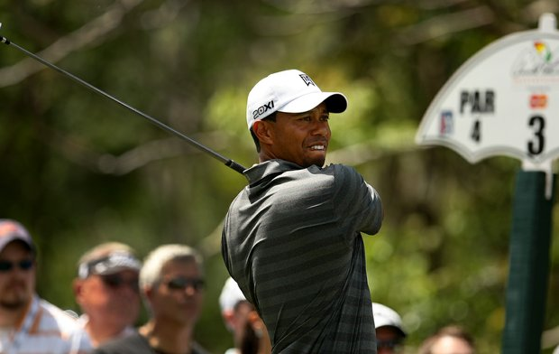 Tiger Woods swings hard at No. 3 during the third round of the Arnold Palmer Invitational.