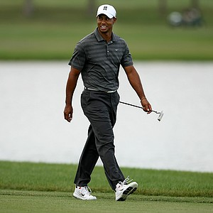 Tiger Woods smiles as he walks up No. 6 during the third round of the Arnold Palmer Invitational.