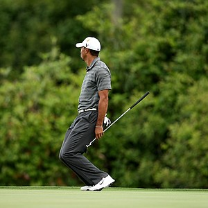 Tiger Woods reacts to narrowly missing his 96 foot eagle putt at No. 6 during the third round.