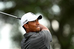 Tiger Woods watches his tee shot at No. 7 during the third round of the Arnold Palmer Invitational.