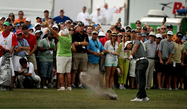 Tiger Woods hits his second shot at No. 9 during the third round of the Arnold Palmer Invitational.