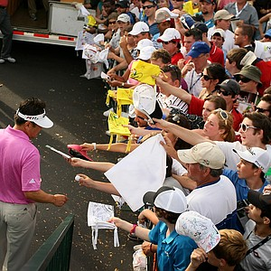 Charlie Wi heads to sign autographs during the third round of the Arnold Palmer Invitational.