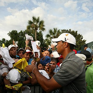 Tiger Woods signs autographs during the third round of the Arnold Palmer Invitational.