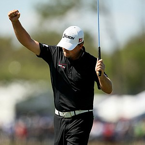 Graeme McDowell reacts to making a 51-foot eagle putt at No. 6 during the the final round.
