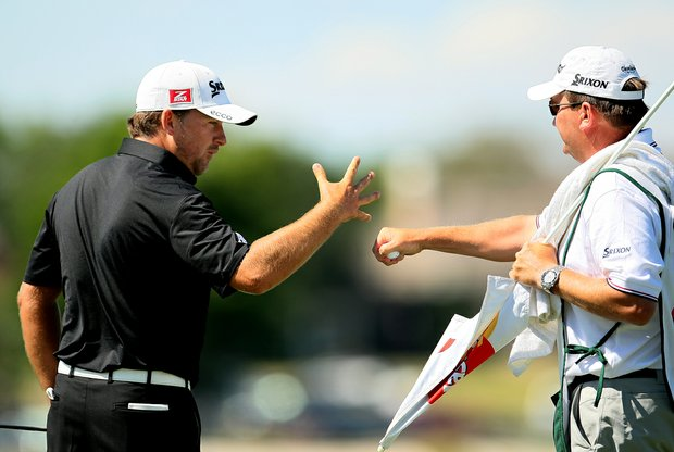 Graeme McDowell celebrates with his caddie after making a 51-foot eagle putt during the the final round.