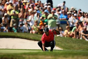 Tiger Woods lines up his putt at No. 7 during the the final round of the Arnold Palmer Invitational.