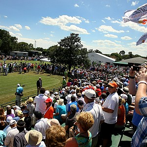 Crowds wait and snap pictures as Tiger Woods prepares on the first tee during the the final round of the Arnold Palmer Invitational.