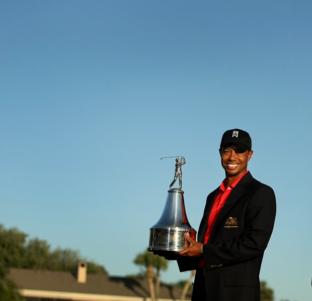 Tiger Woods poses with the trophy after winning the 2012 Arnold Palmer Invitational.