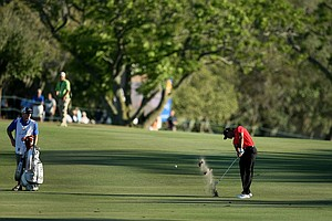 Tiger Woods hits his second shot at No. 18 during the the final round of the Arnold Palmer Invitational.