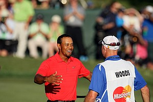 Tiger Woods hugs his caddie Joe LaCava after the last putt during the the final round of the Arnold Palmer Invitational.