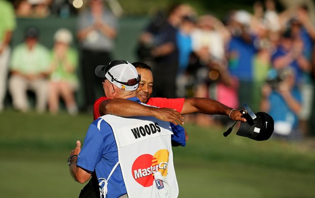 Tiger Woods hugs his caddie Joe LaCava after they won Arnold Palmer Invitational.