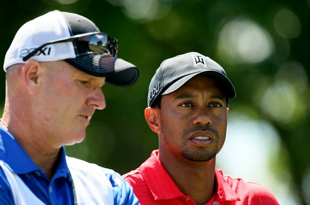 Tiger Woods with his caddie Joe LaCava during the the final round of the Arnold Palmer Invitational.