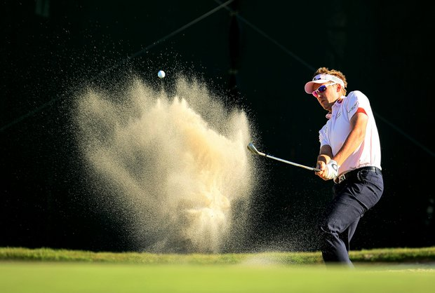 an Poulter blasts out of the bunker at No. 16 during the the final round of the Arnold Palmer Invitational.