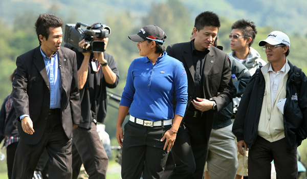 Yani Tseng is escorted by security as she practices during the 2011 Sunrise LPGA Taiwan Championship at Sunrise Golf and Country Club.