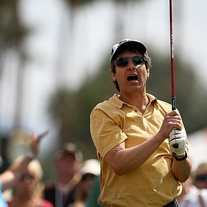 "Actor Ray Romano watches as his tee shot sails ""outside the ropes"" during pro-am on Wednesday at the Kraft Nabisco Championship."