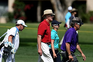 Craig T. Nelson, center, walks with Karrie Webb on Wednesday at the Kraft Nabisco Championship.