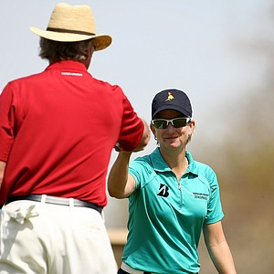 Karrie Webb shares a fist bump with actor Craig T. Nelson after he made a putt at No. 9 during the pro-am on Wednesday.