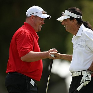 Alice Cooper celebrates making a putt while playing with Jenny Shin during the pro-am on Wednesday.