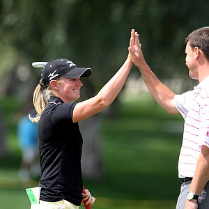 Stacy Lewis gets a high hive after she made eagle during the pro-am on Wednesday.
