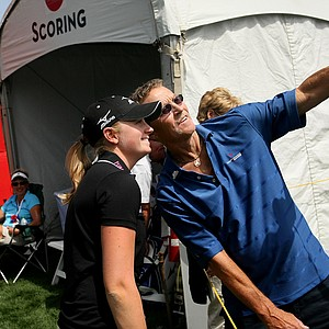 A fan takes a picture with Stacy Lewis after her pro-am appearance Wednesday at the Kraft Nabisco Championship.