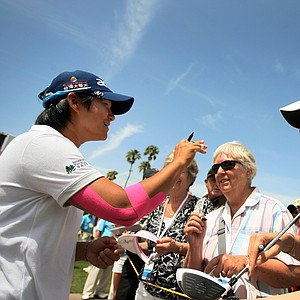 Yani Tseng, left, signs autographs on Wednesday at the Kraft Nabisco Championship.