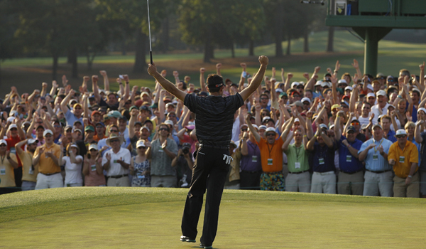 Charl Schwartzel reacts after making a birdie putt on the 18th hole during the final round of the Masters .