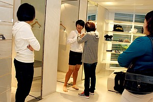 Yani Tseng shops for an outfit for an upcoming event with one of her friends, Ella Chen of the singing group S.H.E.