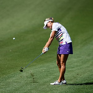 Lexi Thompson hits a shot at No. 9 on Thursday at the Kraft Nabisco Championship.