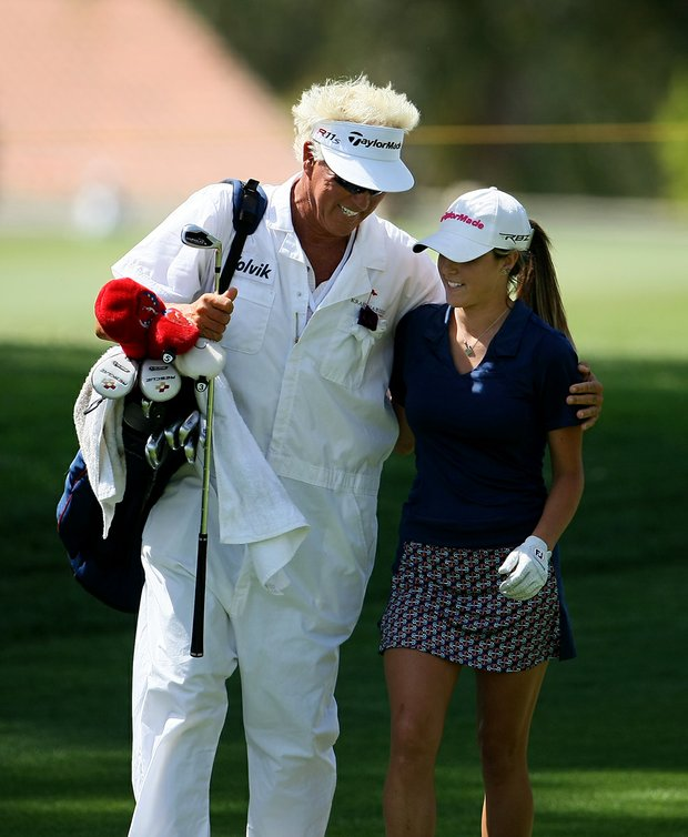 Caddie Donnie Green gives his daughter Jaye Marie Green a hug after her second shot at No. 9.