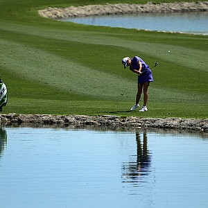 Natalie Gulbis hits a shot at No. 6 on Thursday at the Kraft Nabisco Championship.