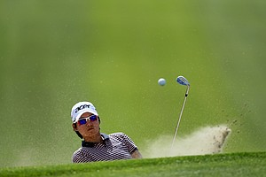 Yani Tseng hits out of the bunker at No. 9 on Thursday at the Kraft Nabisco Championship.
