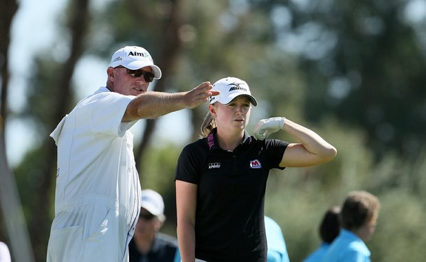 Stacy Lewis with her caddie at No. 3 on Friday at the Kraft Nabisco Championship.