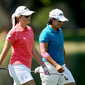 Yani Tseng and Paula Creamer walk down No. 6 on Friday at the Kraft Nabisco Championship. They were paired together Thursday and Friday.