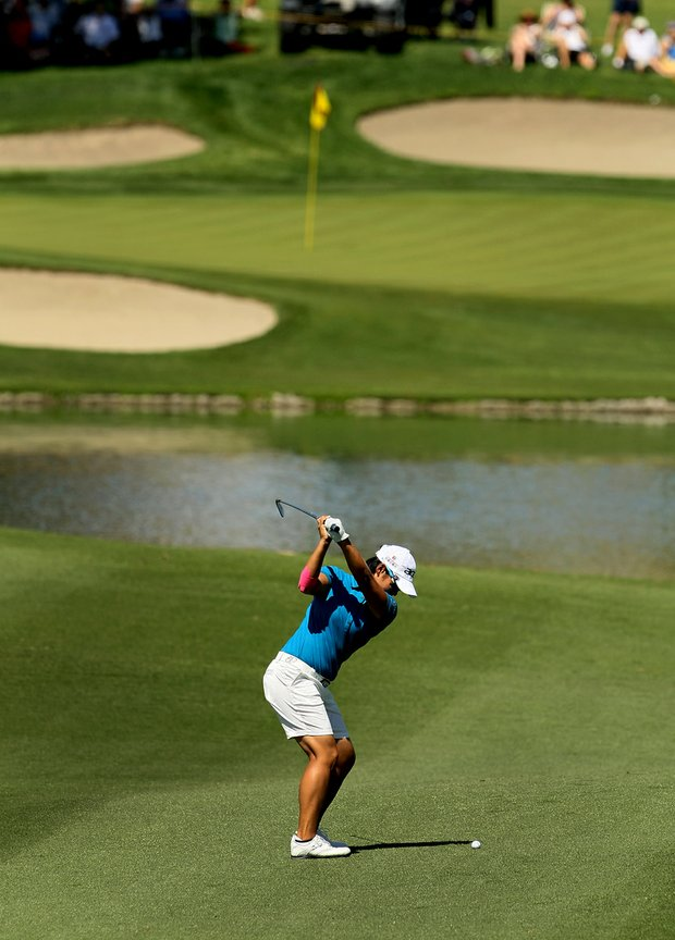 Yani Tseng hits her second shot at No. 6 on Friday at the Kraft Nabisco Championship.