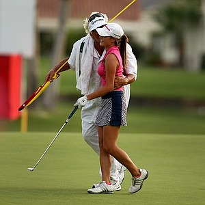 Jaye Marie Green's caddie/father Donnie Green runs to plant a kiss on his daughter's cheek after she birdie No. 18 to get within the cut on Friday at the Kraft Nabisco Championship.