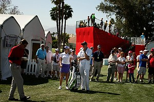 Natalie Gulbis, center, waits for a ruling on her ball near the spectator tents on Saturday at the Kraft Nabisco Championship, she bogeyed the hole.